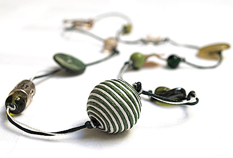 Caroline bead and button necklace - Stylish and eye-catching long necklace. Mixture of green and white beads and buttons of varying sizes. Strung and knotted with double thread and fastened with an ornate toggle bar and ring.