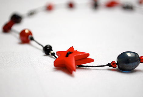 Alison mid-length lariat - Fun knotted lariat necklace with star and flower buttons, interspersed with mixed beads.