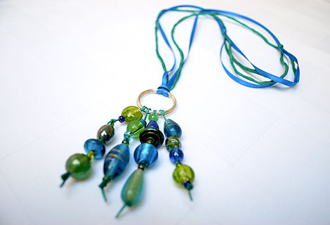 Jane long cluster pendant with sterling silver hoop - Stylish bead cluster pendant and sterling silver hoop hanging from a cord of green silk and blue iridescent ribbon. Length is adjustable by sliding knots.