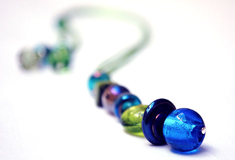 Harlequin peacock blue/green long drop pendant - Funky and bright, this pendant is designed to be worn long, but can be adjusted in length using a sliding bead. Beautiful peacock colour beads hang from silky ribbon cord.