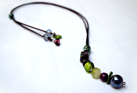 Harlequin burgundy/green long drop pendant - Funky and bright, this pendant is designed to be worn long, but can be adjusted in length using a sliding bead. Beautiful bright green and burgundy beads hang from a silky ribbon cord.