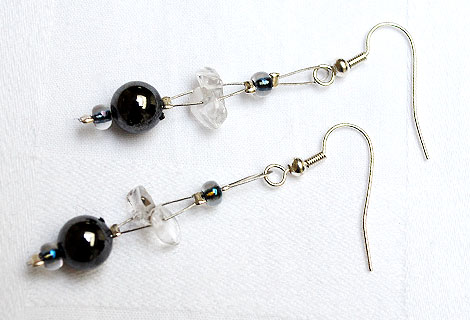 Nicola pearlescent beads and gems floating drop earrings - These exquisite earrings of pearlescent beads, semi-precious gems and organic-shaped black beads float delicately on your ears and add a touch of glamour to any outfit. Silver plated hooks.