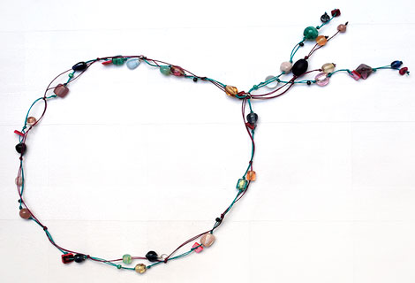 Mari Jo green/pink/blue long knotted lariat - Striking mixed bead lariat necklace designed to be worn to the navel. Strung and knotted onto double thread. Fixed front fastening.