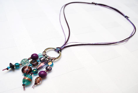 Jane aubergine/turquoise long cluster pendant - Stylish bead cluster pendant and sterling silver hoop hanging from a cord of green silk and blue iridescent ribbon. Length is adjustable by sliding knots.