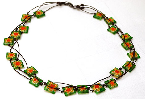 Spangle green 3-tiered necklace - Eye-catching bright green square glass beads with orange flower pattern. Strung in three rows on to knotted dark brown cord. Lobster clasp.